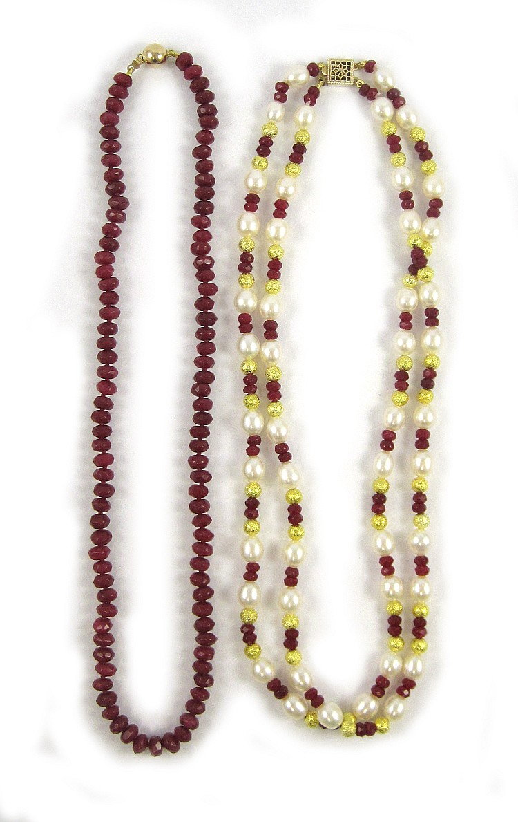 TWO RUBY AND FOURTEEN KARAT GOLD NECKLACES, includ