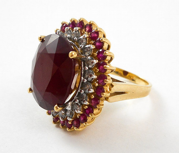 RUBY, DIAMOND AND FOURTEEN KARAT GOLD RING, with 2
