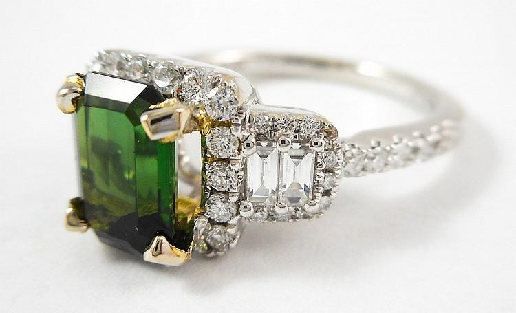 GREEN TOURMALINE AND DIAMOND RING. The 14k white