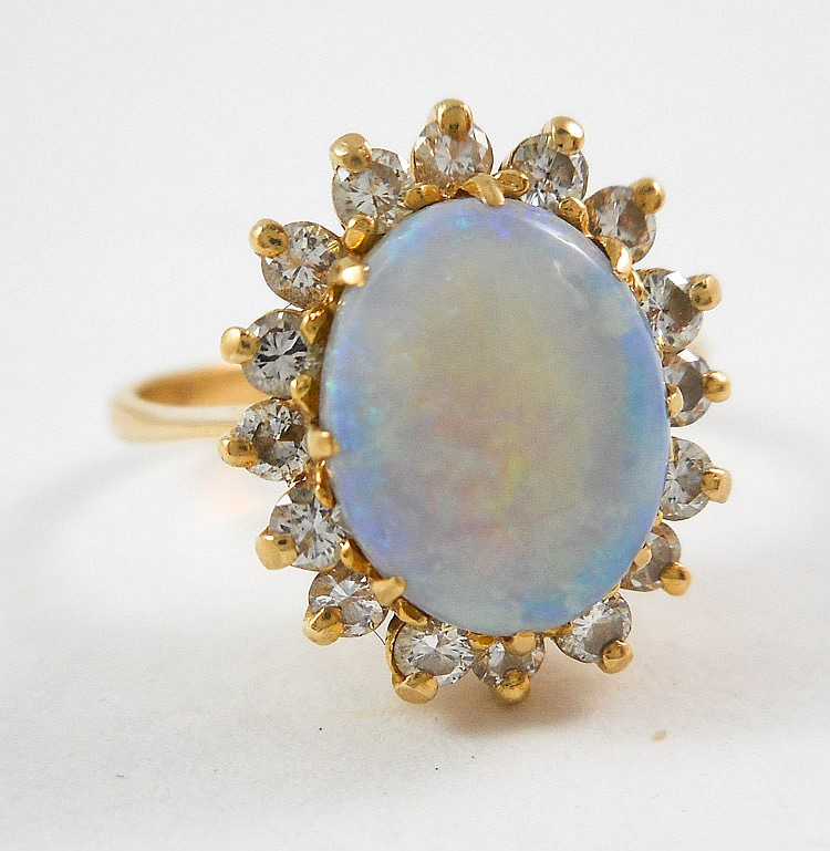 OPAL, DIAMOND AND FOURTEEN KARAT GOLD RING, with 1