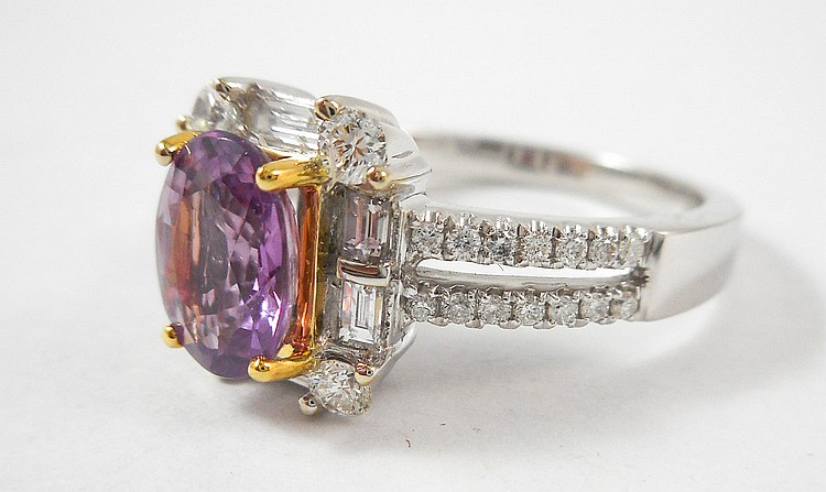 PINK SAPPHIRE AND FOURTEEN KARAT GOLD RING. The w