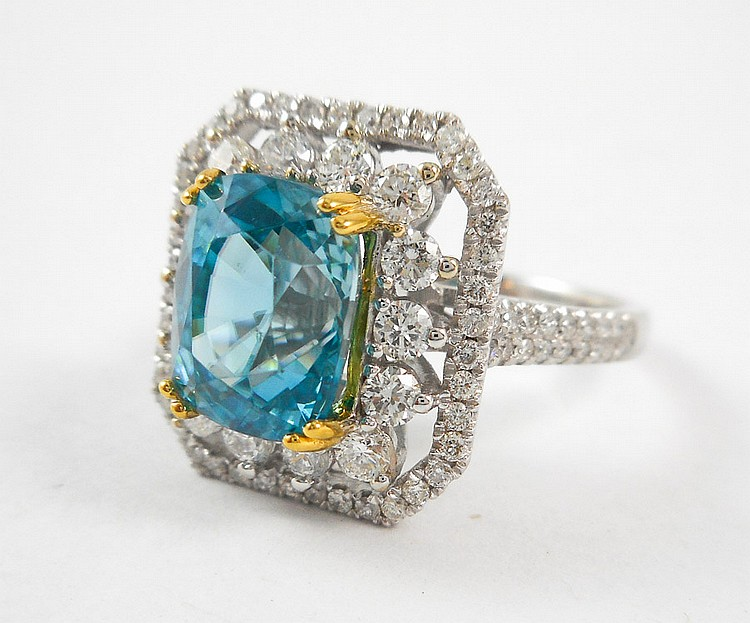 ZIRCON, DIAMOND AND FOURTEEN KARAT GOLD RING. The