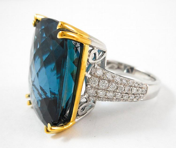 LONDON BLUE TOPAZ AND DIAMOND RING.  The 14k white