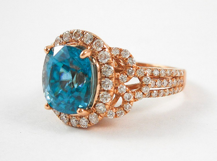 ZIRCON, DIAMOND AND FOURTEEN KARAT ROSE GOLD RING,