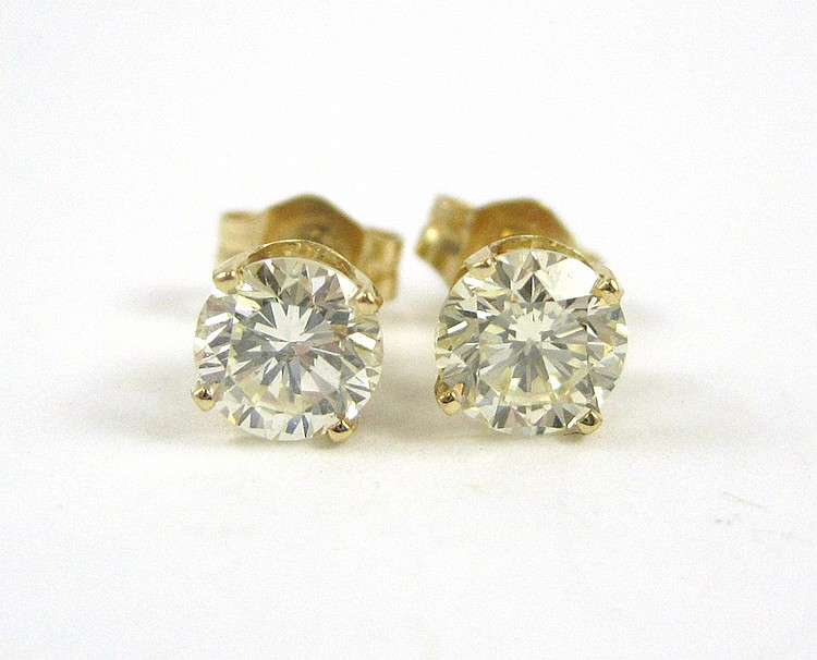 PAIR OF DIAMOND AND YELLOW GOLD EAR STUDS, each 14