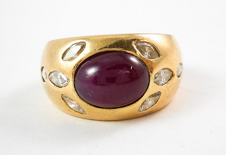 RUBY, DIAMOND AND FOURTEEN KARAT GOLD RING, with f