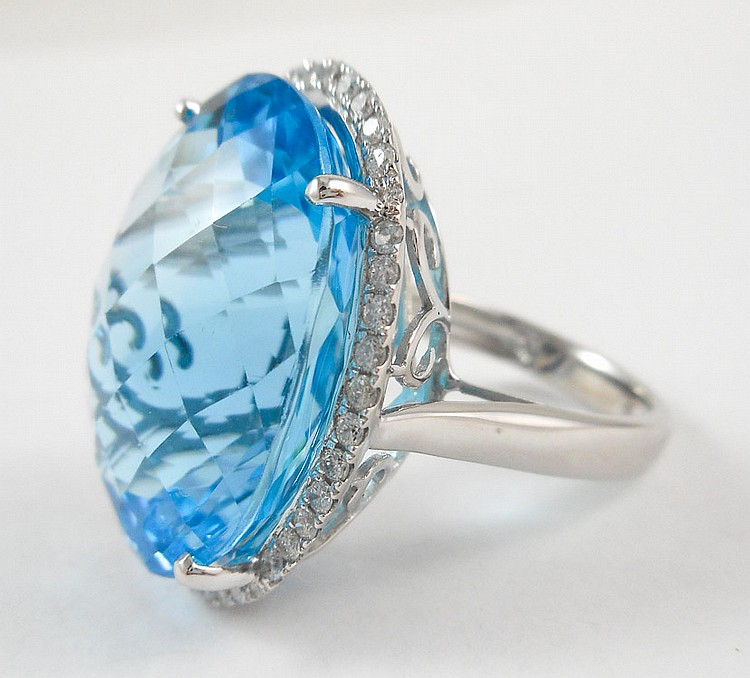 BLUE TOPAZ, DIAMOND AND WHITE GOLD RING.  The 14k