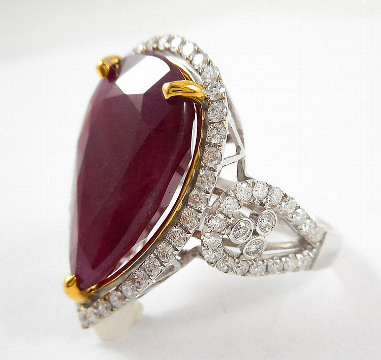 RUBY, DIAMOND AND EIGHTEEN KARAT GOLD RING, with P