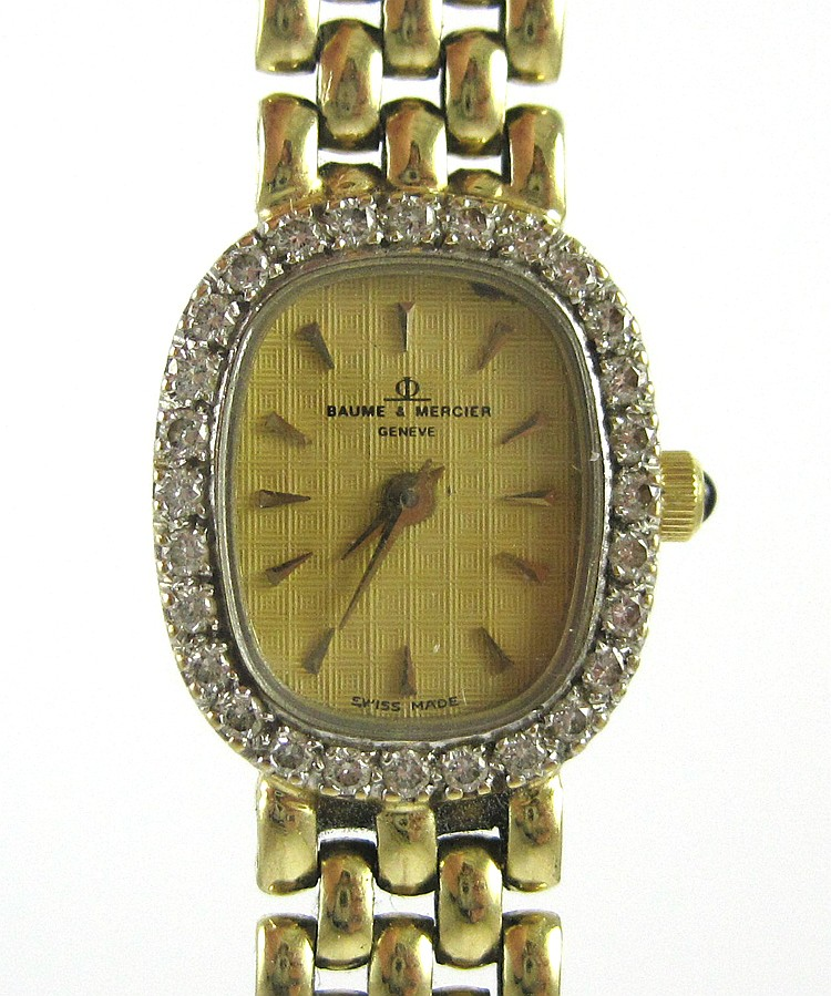 LADY'S BAUME & MERCIER DIAMOND AND YELLOW GOLD WRI