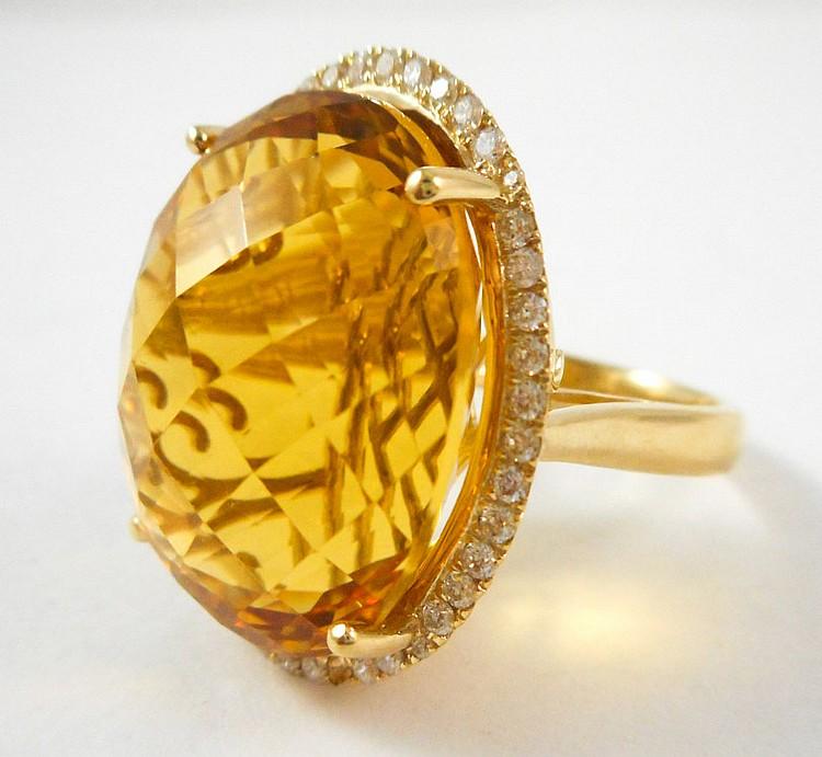CITRINE, DIAMOND AND FOURTEEN KARAT GOLD RING, wit