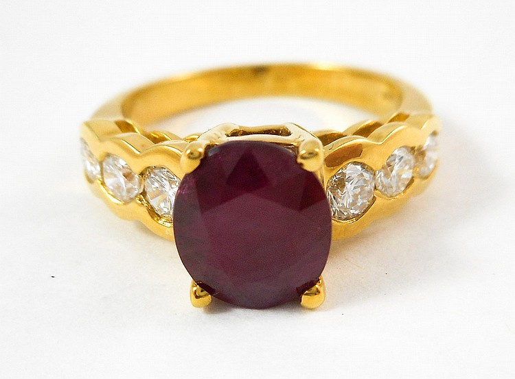 RUBY, DIAMOND AND EIGHTEEN KARAT GOLD RING, with t