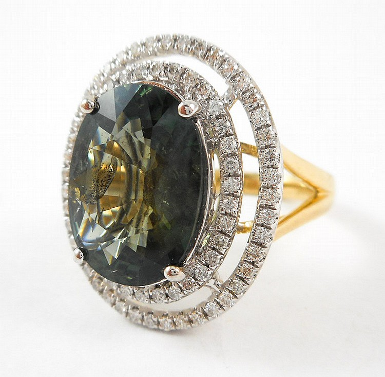 GREEN SAPPHIRE AND FOURTEEN KARAT GOLD RING, with