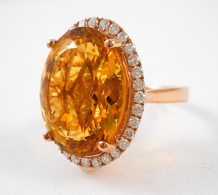 CITRINE, DIAMOND AND FOURTEEN KARAT GOLD RING.  Th