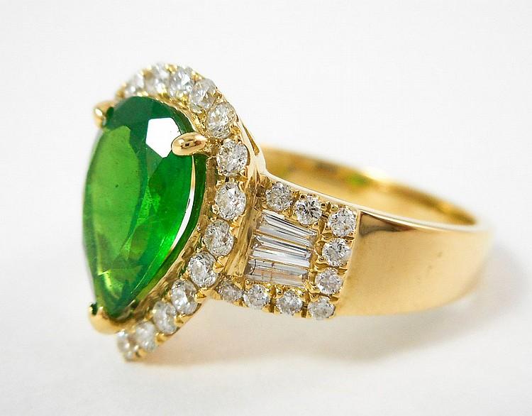 EMERALD, DIAMOND AND FOURTEEN KARAT GOLD RING. Th