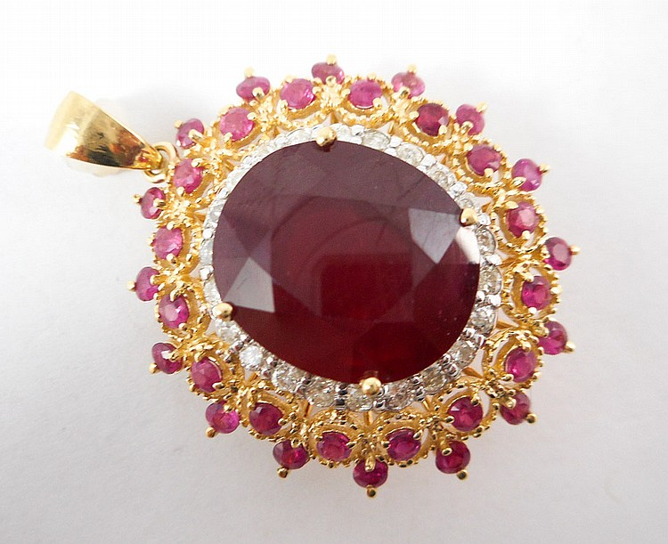 RUBY, DIAMOND AND FOURTEEN KARAT GOLD PENDANT, wit
