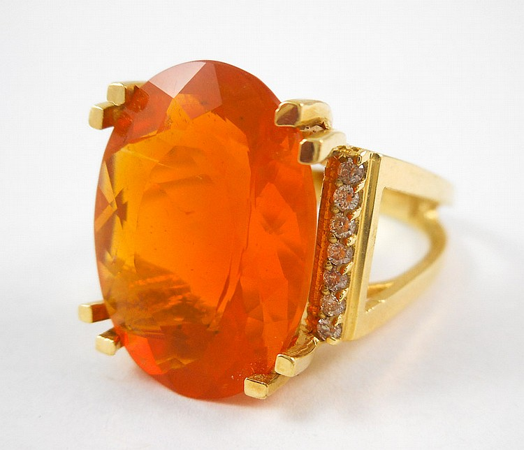 FIRE OPAL, DIAMOND AND FOURTEEN KARAT GOLD RING, w