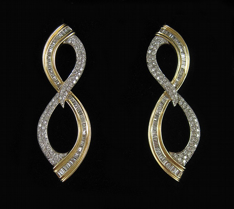 PAIR OF LAURA RAMSEY DIAMOND EARRINGS, each 14k ye