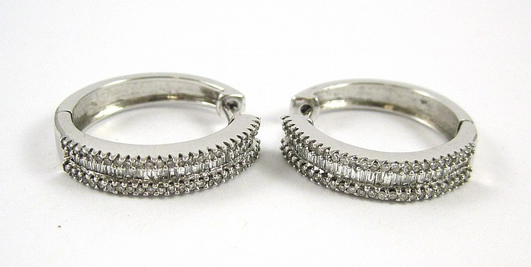PAIR OF LAURA RAMSEY DIAMOND HOOP EARRINGS. The f