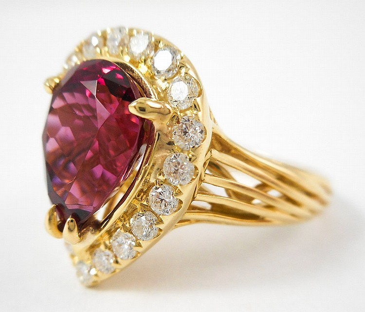 RUBELLITE, DIAMOND AND FOURTEEN KARAT GOLD RING.