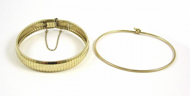 TWO FOURTEEN KARAT GOLD BRACELETS:  1) wire bangle