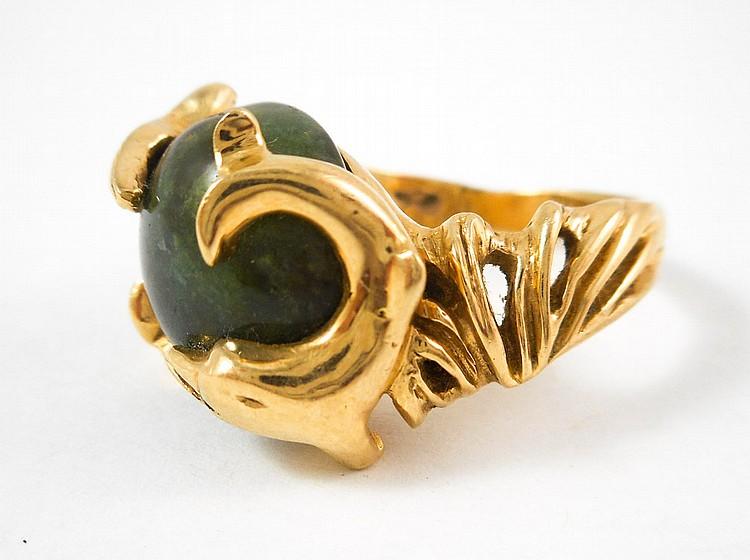 MAN'S JADE AND FOURTEEN KARAT GOLD RING.  The heav