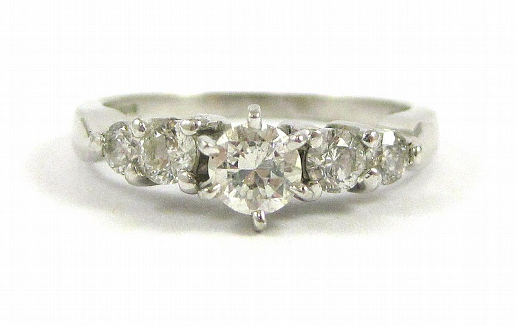 DIAMOND AND PLATINUM RING, with two round-cut diam