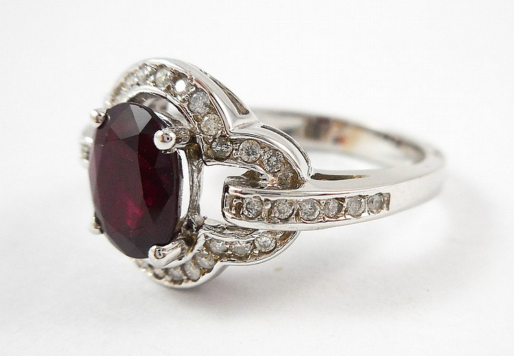 RUBY, DIAMOND AND FOURTEEN KARAT WHITE GOLD RING,