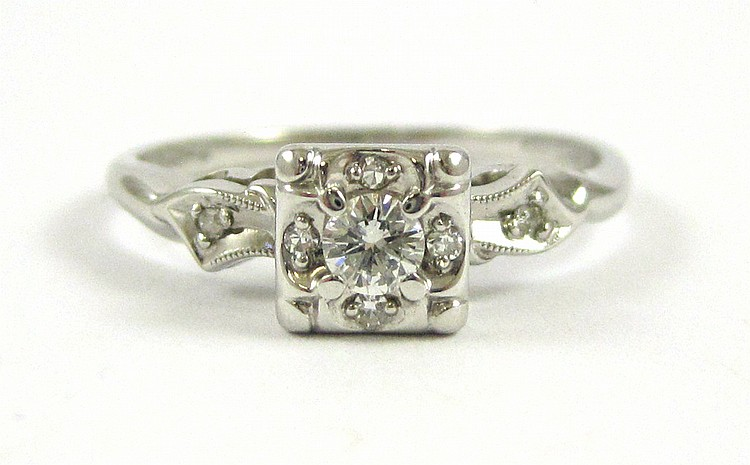 DIAMOND AND FOURTEEN KARAT WHITE GOLD RING, with s