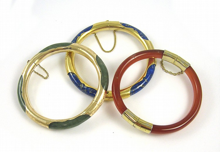 THREE CHINESE GOLD AND HARDSTONE BANGLES: 1) blue