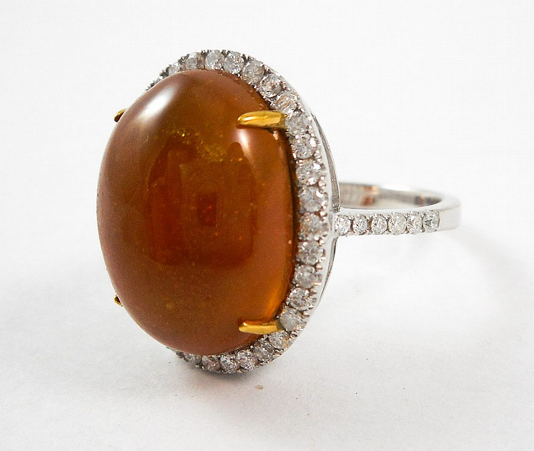 IMPERIAL TOPAZ AND FOURTEEN KARAT WHITE GOLD RING,