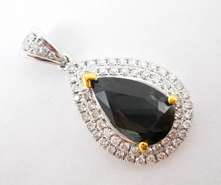 SAPPHIRE AND FOURTEEN KARAT GOLD PENDANT, with AIG
