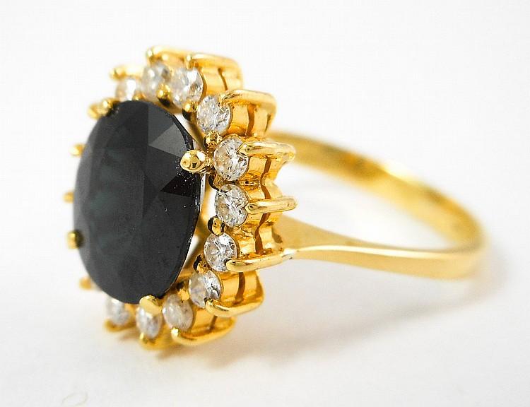 SAPPHIRE, DIAMOND AND EIGHTEEN KARAT GOLD RING, wi