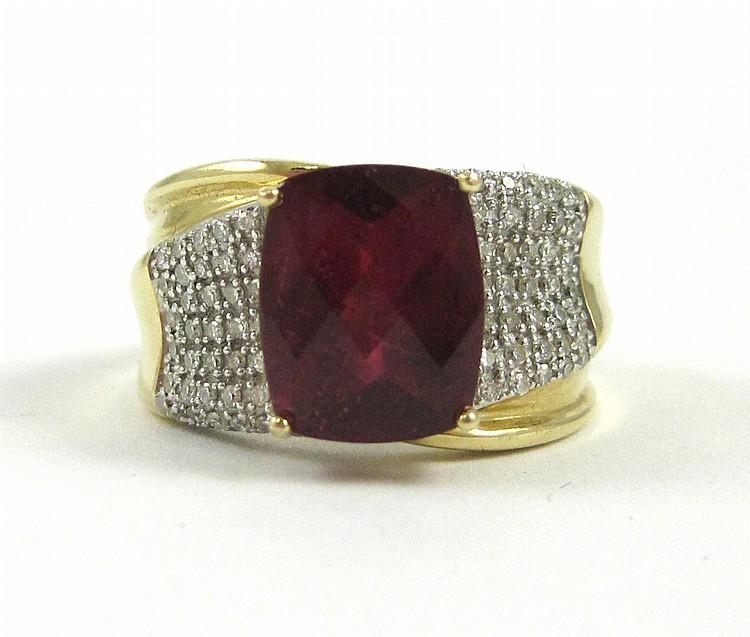 LAURA RAMSEY RUBELLITE AND DIAMOND RING, 14k yello