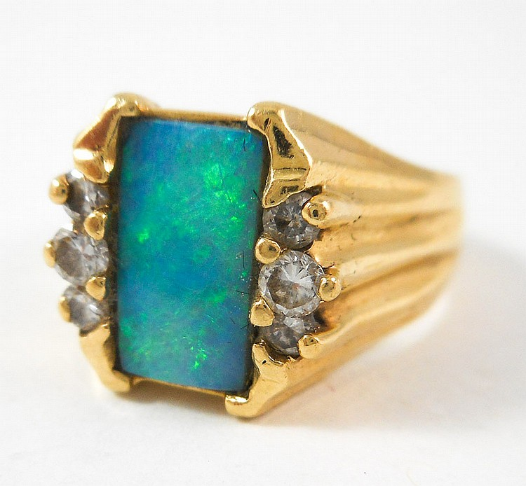 OPAL, DIAMOND AND FOURTEEN KARAT GOLD RING, with t