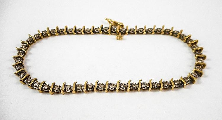 DIAMOND AND FOURTEEN KARAT GOLD BRACELET, measurin