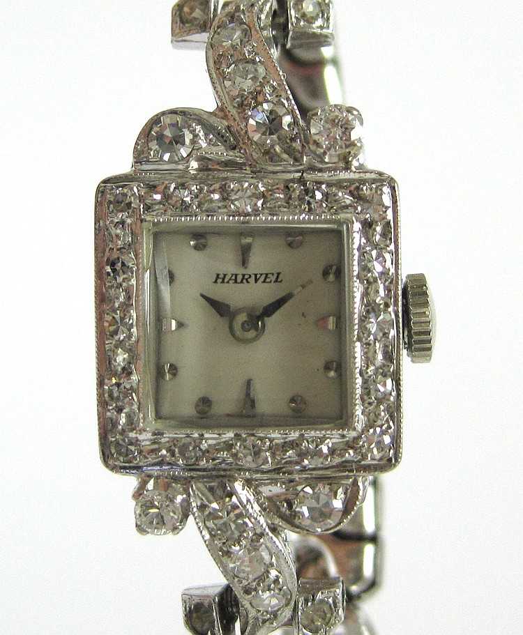 LADY'S DIAMOND AND WHITE GOLD WRIST WATCH WITH APP