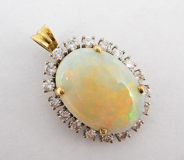 OPAL, DIAMOND AND FOURTEEN KARAT GOLD PENDANT. Th