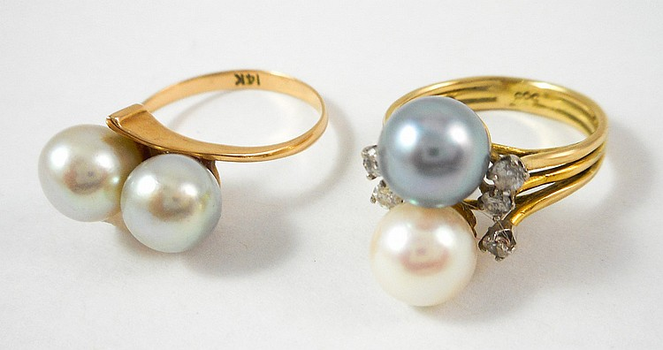 TWO PEARL AND FOURTEEN KARAT GOLD RING, including