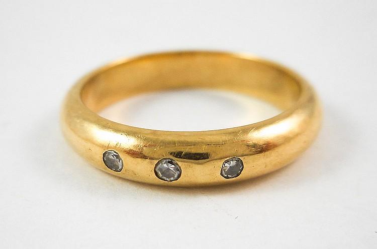 DIAMOND AND FOURTEEN KARAT GOLD RING, bezel set wi