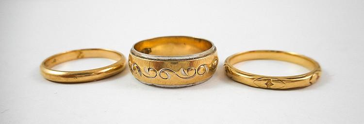 THREE FOURTEEN KARAT YELLOW GOLD RINGS, including