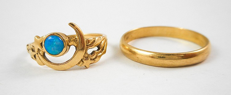 TWO FOURTEEN KARAT YELLOW GOLD RINGS, including a