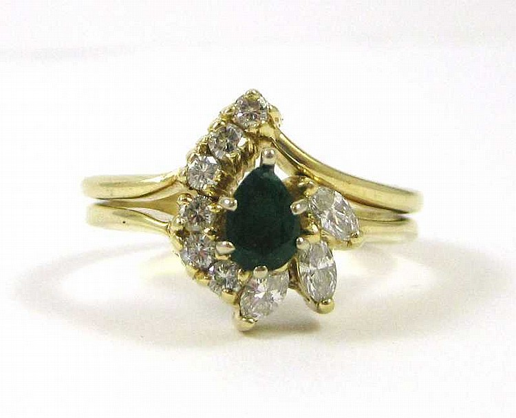 EMERALD, DIAMOND AND FOURTEEN KARAT GOLD RING, wit