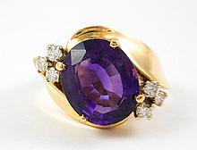 AMETHYST, DIAMOND AND FOURTEEN KARAT GOLD RING, wi