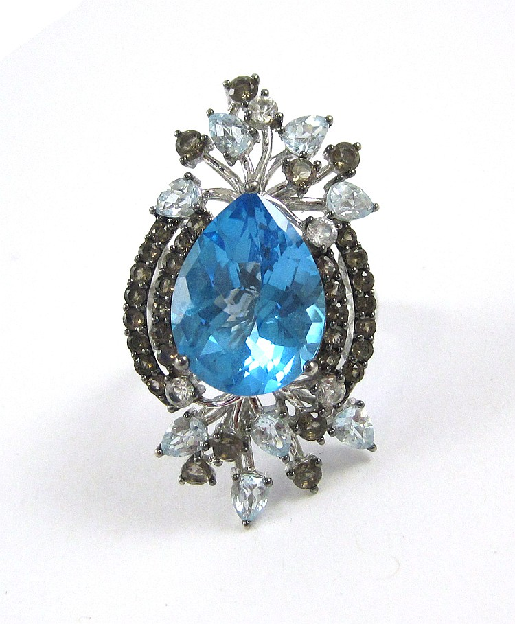 LEVIAN BLUE TOPAZ AND FOURTEEN KARAT GOLD RING. T
