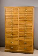 AN OAK FORTY-DRAWER FILE CABINET, American, c. 190