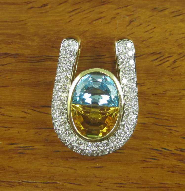 DIAMOND, BLUE TOPAZ AND CITRINE SLIDER PENDANT. T