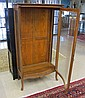 AN OAK AND CURVED GLASS CHINA CABINET, American,