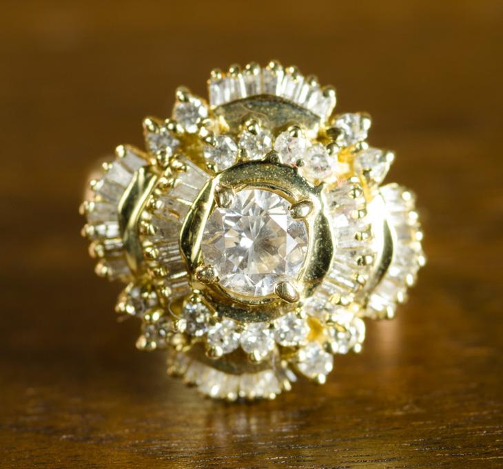 DIAMOND AND FOURTEEN KARAT GOLD RING, with PGL app