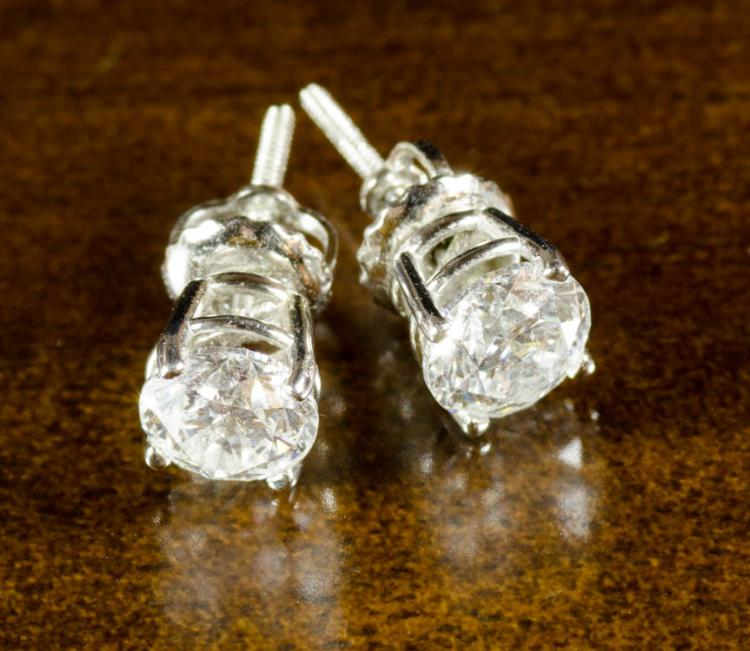 PAIR OF DIAMOND AND WHITE GOLD EAR STUDS, with GSL