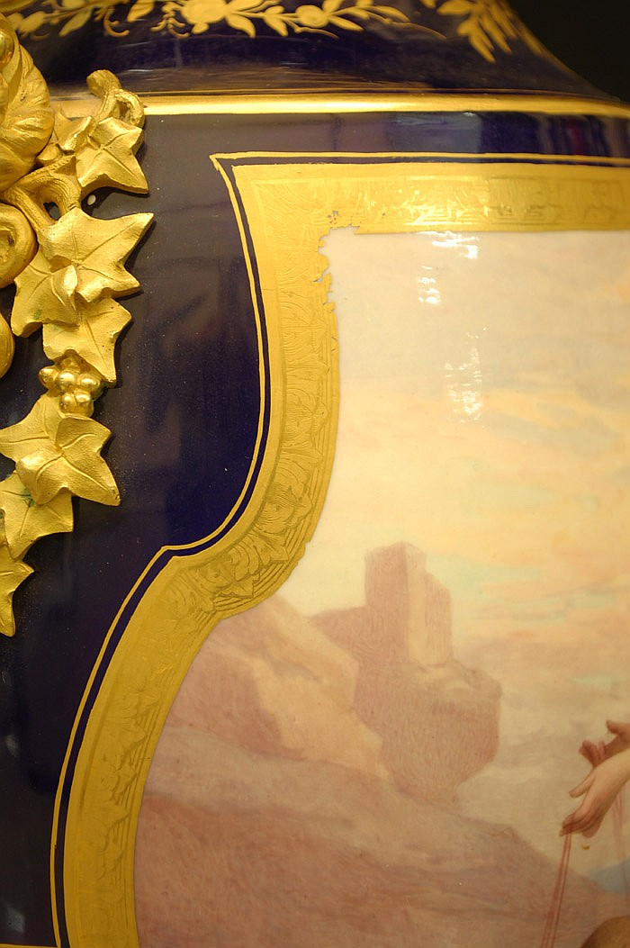 PAIR OF SEVRES PORCELAIN GILT BRONZE MOUNTED URNS